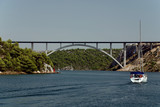 yacht and bridge over the sea near Sibenik (Croatia) poster