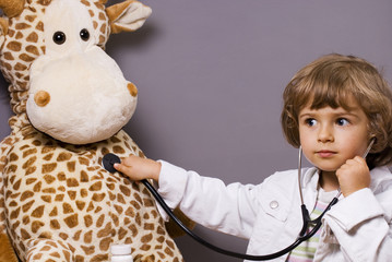 beautiful four years old playing with stethoscope