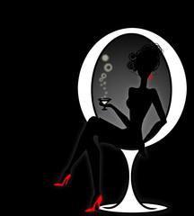 figura di donna seduta