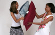 Mother and daughter pillow fight