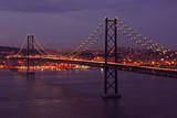 Suspension bridge by twilight near Lisbon in Portugal poster