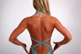 Blond bodybuilder flexing back poster