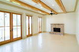white unfurnished livingroom with wood beams poster