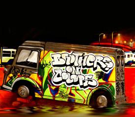 Colourful graffiti image of a bus