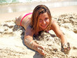 attractive woman playing wtih sand