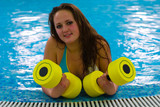 girl with dumbbells for aqua aerobics in pool (Welcome to sport) poster