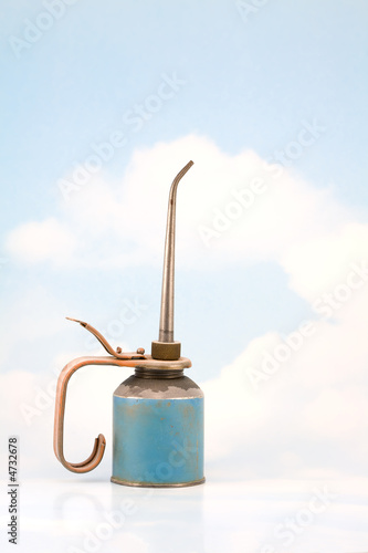 Old Oil Can on Sky Background