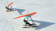 Two hang-gliders on winter lake - 4735613