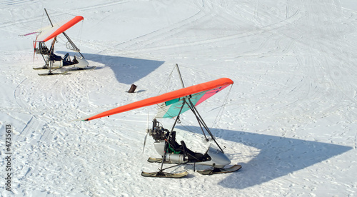 Two hang-gliders on winter lake
