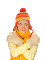 Frozen girl in colorful winter clothing over white background