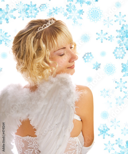 Blond angel girl and abstract snowflakes around her