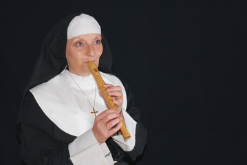 Nun playing the recorder