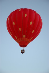 Red orange hot air balloon with yellow dots
