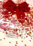 Christmas party background with red bow and confetti poster