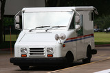 White Mail Truck Delivering Mail