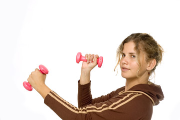 Young Fitness girl with dumbells - isolated over white