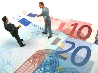 businessmen on Euro notes