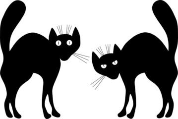 Two black cats. A vector illustration. Contour.