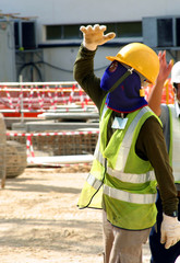 Worker on condominium construction site