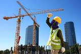 Worker on condominium construction site poster
