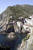 View of Riomaggiore train starion and cliffside cafes