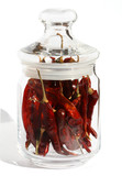 red hot chili pepper stems in a glass jar poster