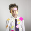Boy covered with sticky notes