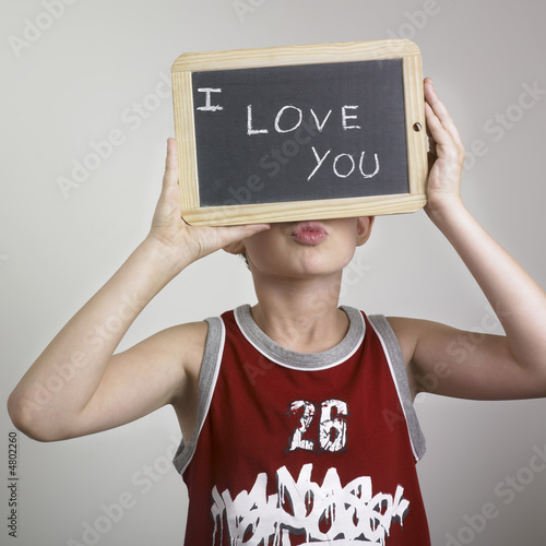 Young boy holding sign
