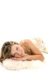 Beautiful woman  laying on white fur