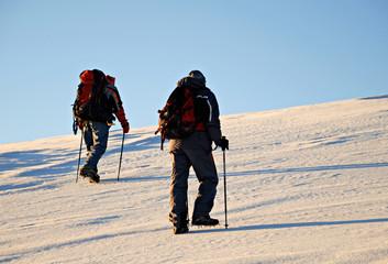 Two climbers hiking.
