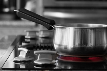 saucepan on stove - hot burner