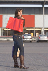 Woman with red shopping bag