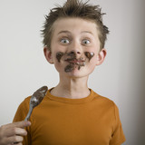 Boy eating chocolate messily