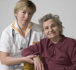An elderly women by a doctor