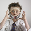 Boy with phones banded on head