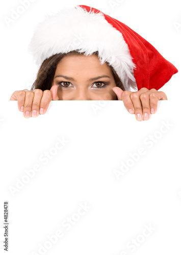 female santa over a billboard