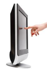 Woman hand touching tv screen