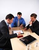 Three businessmen handling negotiations.