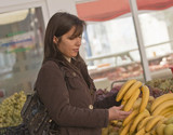 Woman buying banans poster