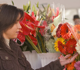 Woman buying flowers poster