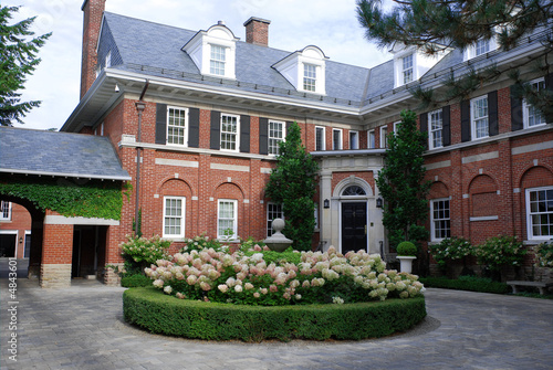 Large house with hydrangea in circular driveway