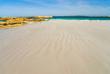 Beautiful streaky beach leading to rocky headland