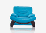 Stylish leather sofa of turquoise color with wooden legs poster
