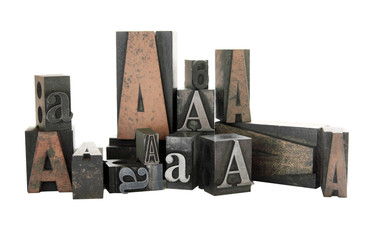 the letter A in both wood and metal type