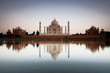 Taj Mahal reflected in river at twilight