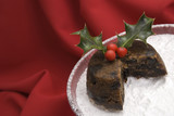 Christmas pudding with holly & berries with a slice cut away poster