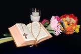 bible with candle and flower