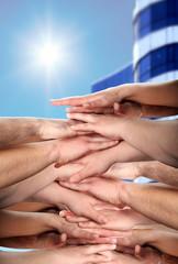 hands clasped under sun shine