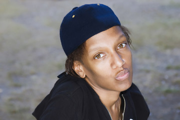 Beautiful black woman in a blue cap