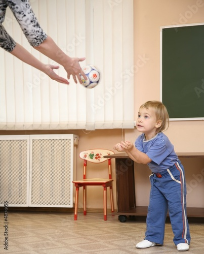 little girl with ball